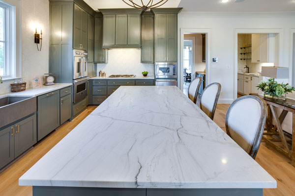 Island bench made from white quartzite in a modern kitchen